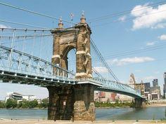 Roebling Suspension Bridge.  If you grew up in Cincinnati - You were taught that the original Brooklyn Bridge connects Cincinnati to Covington and is called the John A. Roebling Suspension Bridge.