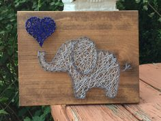 """This listing is for an Elephant string art sign. This sign would be perfect for a nursery or children's room! This sign measures approximately 9.25"""" x 12"""". Boards can be stained with Special Walnut, Dark Walnut, or Classic Gray (examples above). Please include color choice in note"""