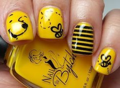 Winnie the Pooh nail art: two colors colours design: yellow base with black stripes, honey bees and Pooh. #spring #summer
