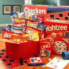 Family Game Night Basket: filled with family board games, popcorn and snacks.