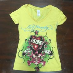 Ed Hardy Love Kills Slowly T-shirt ☠ Authentic Ed Hardy size XS, yellow love kills slowly tattoo print. Worn a few times. In great condition.  That is a shadow on the back of the shirt. It has no marks, dirt or damage Ed Hardy Tops Tees - Short Sleeve