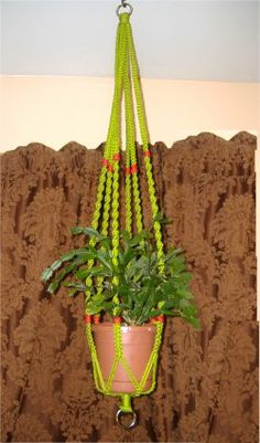 simple macrame plant hangers tutorial. these are really easy.. just a series of simple knots or laying one cord or another to produce twists.  it really is easy.. i have a board with a nail in it that holds my cords while I macrame.. You can do this! and choose your own colors instead of what you find in the stores.. it's fun and relaxing to make it yourself!