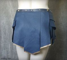 This is a beautiful replica of the Greek-styled leather skirt that Gal Gadot wears in the upcoming Wonder Woman movie. It is made of genuine chrome-tanned leather in the perfect cornflower blue, colorfast and beautifully textured, with buttery-soft suede on the underside. It is comprised of seventeen overlapping panels that give the skirt a nice, full weight and surprisingly good coverage, while allowing for an unlimited range of motion. The tips are gilded with high-quality artists acrylic…