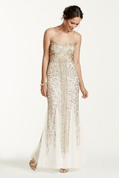 This unforgettable dress packs major wow factor with its over-the-top beading!  Ultra-feminine sweetheart bodice is covered with dazzling sequins and bugle beads.  Dramatic, linear sequin beading design down the front elongates your silhouette.  Soft godets add drama and movement.  Fully lined. Imported polyester. Back zipper. Professional spot clean only.