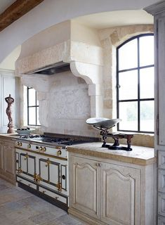 beach house | by homer oatman ~ how Julien's chateau kitchen might look...