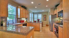 Kitchen with maple cabinets and granite counters. Santa Clara.