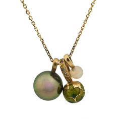 Meenakari bead set with yellow diamonds, complimented by white opal and Tahitian pearl on an 18ct gold chain