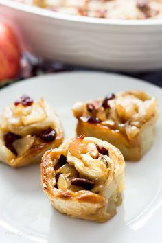 Classic apple pie flavors baked into Apple Pie Puff Pastry Rolls. Easy apple cranberry filling inside puff pastry layers, baked as a pull-apart casserole Puff Pastry Apple Pie, Puff Pastry Recipes, Apple Desserts, Easy Desserts, Sweet Desserts, Healthy Desserts, Scones, Best Dessert Recipes, Cookbook Recipes