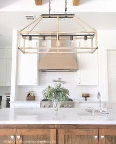 - Overview - Details - Why We Love It - Emilie's clean lines and airy open cage structure highlights 'less is more' with modern farmhouse style. One of our favorite touches is the contrast between the
