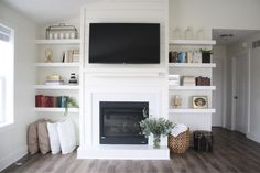 Fireplace with built in shelves. White home inspo