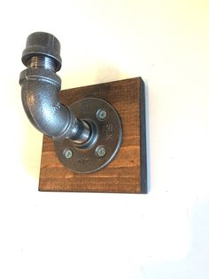 A personal favorite from my Etsy shop https://www.etsy.com/listing/520049394/urban-industrial-pipe-wall-hook-with