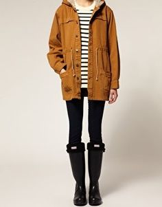 Mustard cargo parka, black skinny jeans and hunter boots
