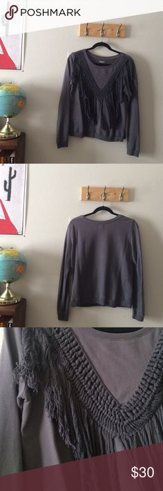 UO top Grey sweatshirt like top with fringe-y front detail // I LOVE this top, it just doesn't fit me anymore // great condition - no rips or obvious stains // minor pilling throughout Urban Outfitters Tops Tees - Long Sleeve