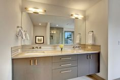 Bright, open bathroom. Built-in vanity with marble countertop. Ambient lighting. LimeLite Development Homes   Bellevue WA   Bright. Green. Living.