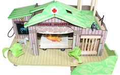 This fantastic wooden jungle hospital is fully painted in camouflage shades of green and brown with jungle motifs.