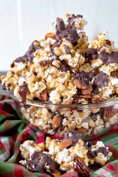 Crunchy, sweet, and chocolatey, caramel corn sprinkled with three kinds of nuts, and drizzled in two types of chocolate. This easy, crunchy, delicious popcorn is great for a crowd. Just be warned, you won't be able to stop snacking once you start. There is nothing better than the crunch of a caramel coated popcorn...that is, until you drizzle it with white and milk chocolate, and toss in pecans, almonds, and peanuts. Then I am hooked! Confession time, I love popcorn. Like rates in one of my…