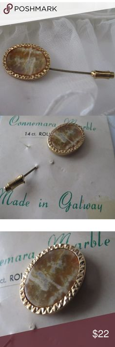 14 Ct Rolled Gold Connemara Marble Stick Pin Nice Connemara Marble Stick Pin found from a Mississippi estate.  Pin is on original card.   14k rolled gold  Made in Galway.   2 1/8 in length 5/8 in width at widest part. Vintage Jewelry Brooches
