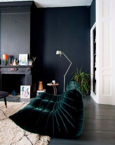 black walls and emerald green velvet sofa. / sfgirlbybay