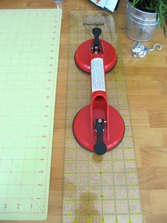 """Listed as """"Dual Cup Suction Lifter"""" from Harbor Freight - use to hold your quilting ruler while using your rotary blade on fabric. this chick has an awesome craft room and economical ideas!"""