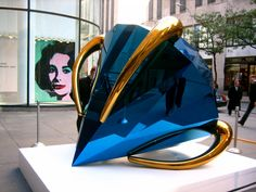 Artist Jeff Koons.  the 'Blue diamond' from 2005! Made of shiny stainless steel and seven-feet wide
