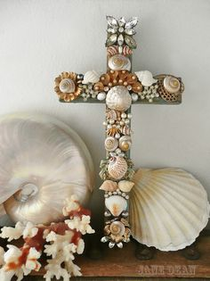 Seashell and Rhinestone Cross embellished wall decor by janedean