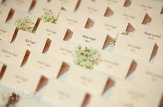 Simple escort cards adorned in stems of baby's breath. | A Simply Chic Wedding Day | Your Something Blue