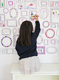 Easy DIY Frames Wallpaper. Encourage your kids' creativity and art by making your own removable frames wallpaper!