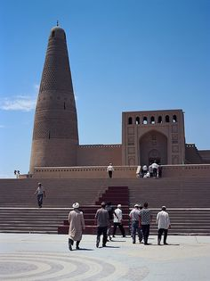 The 18th century Emin Mosque in Turpan. On any Friday around a third of the men who worship at the mosque are not local, but in fact tourists from other areas of Xinjiang. While the Chinese government may make it difficult for Uyghurs to get passports to make a pilgrimage to Mecca, the recent improvements in transportation have certainly made it easier for tour buses to reach Turpan.    Turpan, Xinjiang, July 2011, Fuji GA645zi