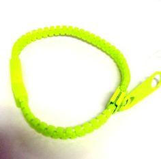 Hip Zip Zipper Bracelet - NEON GREEN Abernook. $8.00. Our hip zip is a trendy piece of fashion jewelry that is available in a variety of colors.. Be Hip and Zip it!  Zipper actually works!  NEON Green. Wear one or all colors at at the same time. Great for teen gifts to wear with your BFF's. Teen Gifts, Gifts For Teens, Neon Colors, All The Colors, Zipper Bracelet, Neon Green, Jewelry Bracelets, Fashion Jewelry, How To Wear
