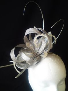 Sinamay teardrop base with sinamay loops with added crystals and stripped  quills. Margo Chamberlain Millinery · Mother of the Bride small fascinators 729ff39ad42