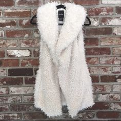 White Fur Vest Gorgeous white fur vest, extremely soft and warm! Looks great over a blouse or dress. Jackets & Coats Vests
