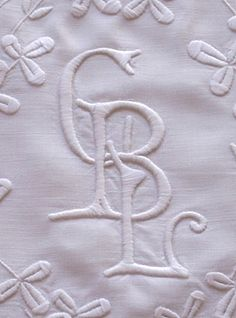 http://www.emsheart.com/merchandise/items/P24608%20antique%20linen%20monogrammed%20pillowcase.htm