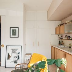 A wall of hidden cabinets at the end of the kitchen.