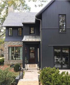 black windows, black house + some natural wood/metal/stone love these windows