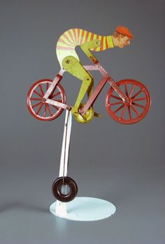 Bicycle Balancing Toy  balance toy  ca.1900  Materialtinplate | wire | metal OriginUSA Object ID107.3581