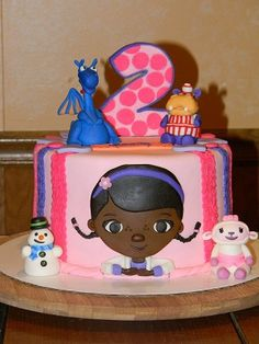 Makayla requested a pink and purple birthday cake with Doc McStuffins, Lamby, Haley, Chillie and Stuffy, with black frosting for Doc& hair! Doc Mcstuffins Cupcakes, Doc Mcstuffins Birthday Cake, 3rd Birthday Parties, 4th Birthday, Birthday Ideas, Birthday Cakes, Purple Birthday, Disney Cakes, Party Time