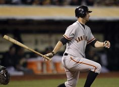 San Francisco Giants' Brandon Belt follows through on an RBI single off Oakland Athletics' Tyson Ross during the fourth inning of an exhibition baseball game Tuesday, April 3, 2012, in Oakland, Calif. (AP Photo/Ben Margot)