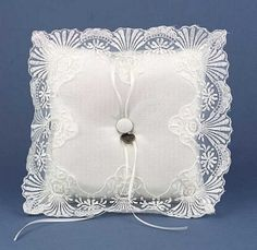 "Retro Vintage Ring Bearer Pillow    This beautiful retro vintage ring bearer pillow measures 10"" x 10"" and showcases delicate ivory lace embroidered trim with a Celtic inspired heart charm with an eternal unending knot design and satin ribbon ring tie.     Retails for $49.95"