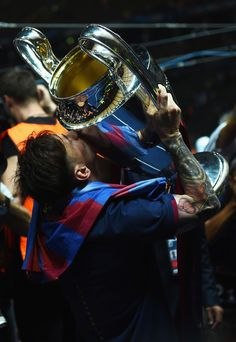 Lionel Messi of Barcelona kisses the trophy after the UEFA Champions League Final between Juventus and FC Barcelona at Olympiastadion on June 6, 2015 in Berlin, Germany.