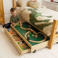 A new spin on a trundle bed - such a great idea.