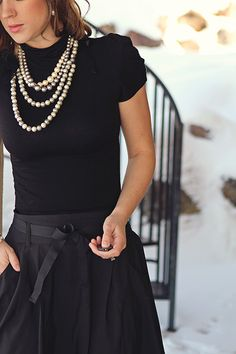 Black turtleneck, skirt & pearls