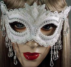 white mask with glass beads -- http://www.gypsyrenaissance.net/maskimages/masquerademaskimages.html