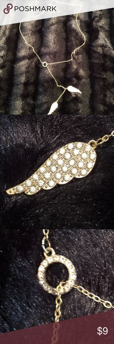 Fashion necklace, gold tone with rhinestones These Beautiful angel wing necklace is in excellent condition. Only worn a few times. No clasp, just slides over your head. Jewelry Necklaces