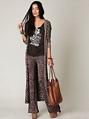 Printed shirt with printed long cardigan and printed bell bottoms. This look is a great day look!