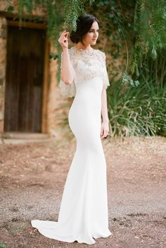 we are loving the new trend of capes over simple and elegant wedding dresses | see the 5 fall wedding dress trends for 2014 here: http://www.mywedding.com/articles/5-wedding-dress-trends-for-fall/