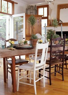 Country Living: I like the different types of seating around the table. Have the table; need the chairs. Mismatched Dining Chairs, Dining Furniture, Dining Rooms, Rustic Table, Better Homes And Gardens, Home Decor Inspiration, Kitchen Remodel, House Design, Garden Design