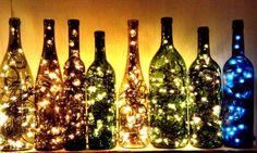 83 Extremely Fun and Creative DIY Wine Bottle Crafts for Kids #winebottleart #glassbottlecrafts #bottledecoration #decoratedwinebottles #diywinebottles #winebottlecrafts Garden Night Lighting, Bottle Lights, Lighted Wine Bottles, Glass Bottles, Recycled Wine Bottles, Blue Bottle, Unique Lighting, Battery String Lights, Lamp Light