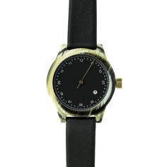 The Minuteman features two different versions of its face. One, a standard two-hand model with hour & minute display – an elegant circular tip highlights the hour index. Secondly, a cleaner, single hand readout using only an hour hand, announcing the passage of time in five-minute intervals. Taking a simple, elegant & understated approach, the single hand acts as both hour & minute marker – with seconds consigned to history. The face of the watch features 12 long tick marks denoting hours…