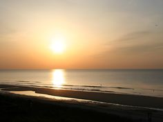 Watch the sun rise on the beach