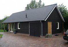 Door bouwbedrijf Bert Jansen B.V. in Kesteren gerealiseerde gepotdekselde schuur, welke gebruikt wordt als kantoor en bergruimte